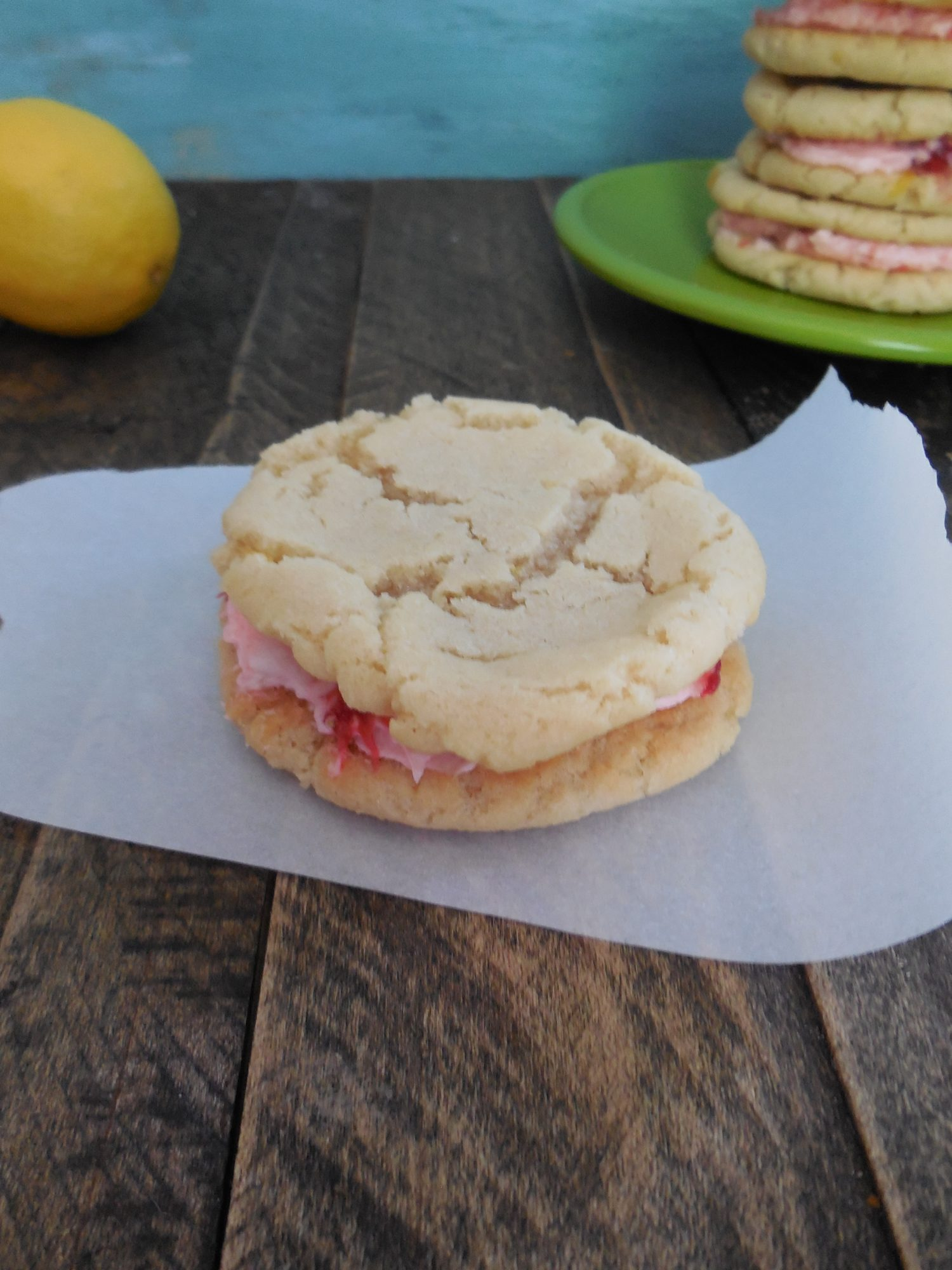 Lemon Sandwich Cookies With Strawberry Lemon Buttercream Frosting ...