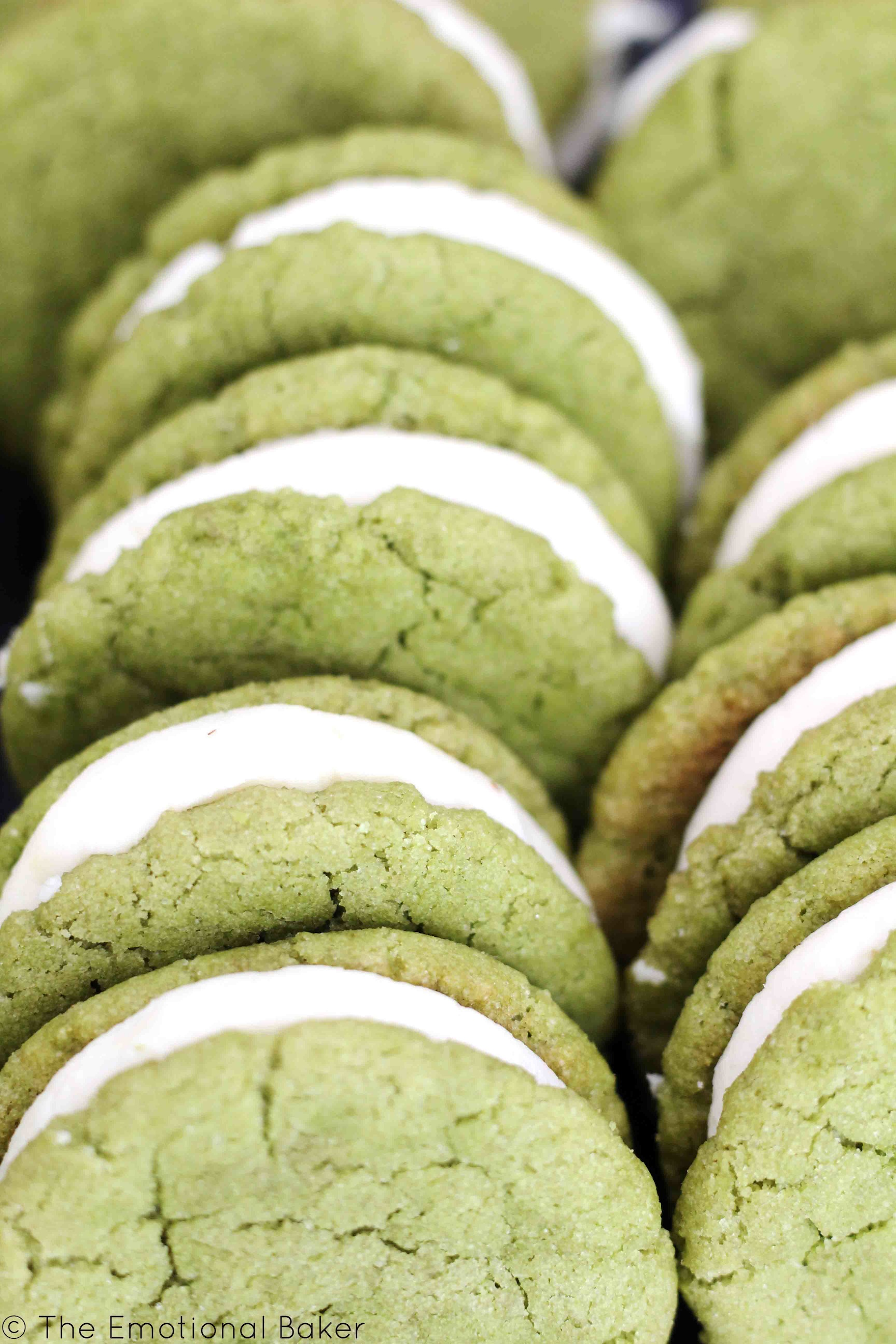 Matcha Almond Sandwich Cookies -- Green tea cookies flavored with almond and paired with a creamy frosting.