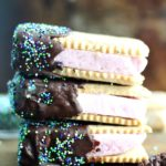 Vegan Chocolate Dipped Frozen Dessert Sandwiches -- Creamy frozen dessert sandwiched between homemade vanilla graham flavored crackers. The only treat you need this summer!