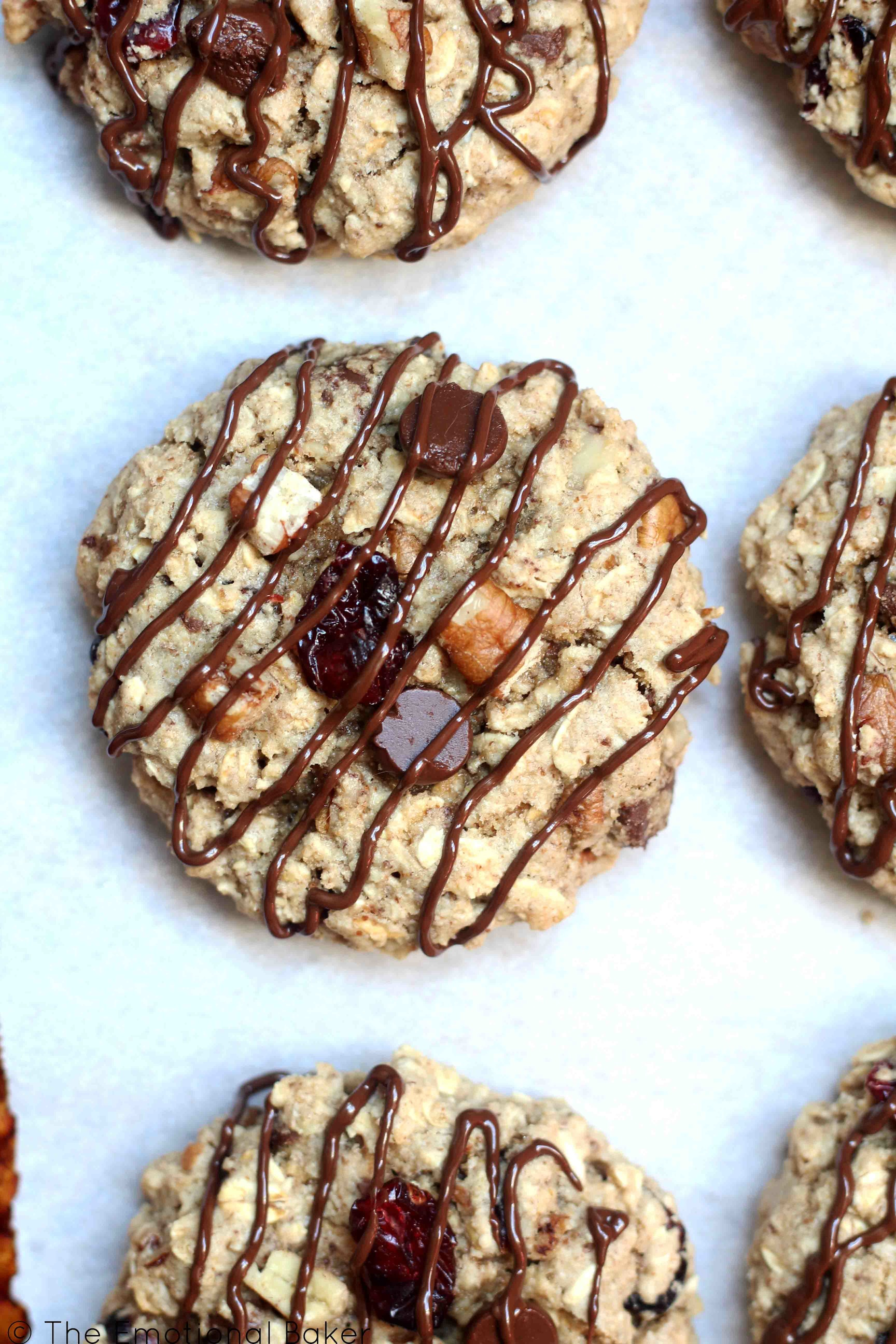 Cranberry Pecan Oat Cookies -- A guilt free cookie sweetened with maple syrup and packed with oats, cranberries, pecans, and chocolate!