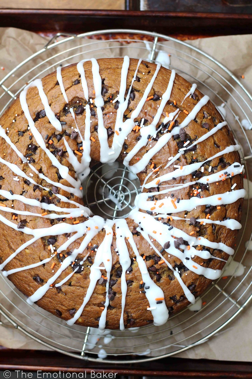 This Vegan Pumpkin Chocolate Chip Bundt Cake is perfectly spiced, filled with chocolate and topped with a simple icing.