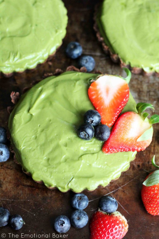 This Matcha Tart is secretly healthy! It's vegan, sweetened with coconut sugar and maple syrup and has a whole wheat chocolate crust.