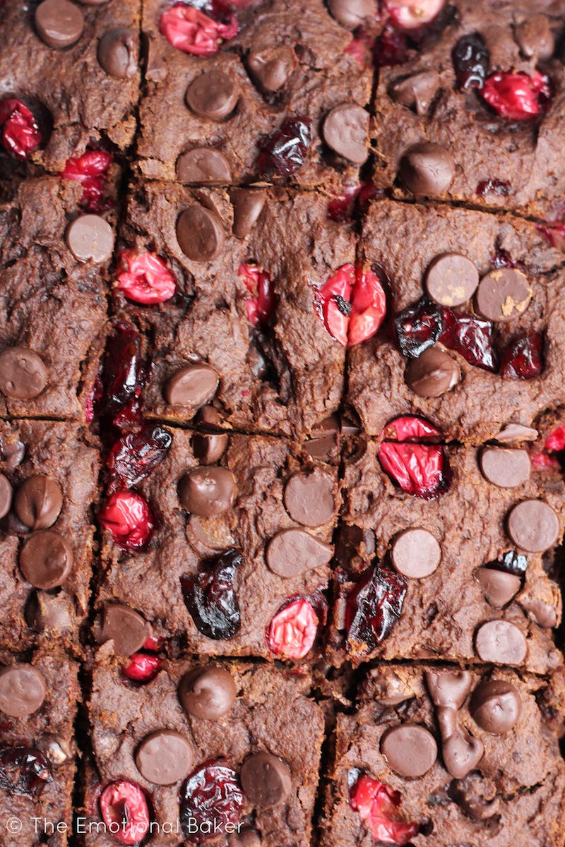 These Vegan Dark Chocolate Brownies are the perfect combo of cake-y and fudge-y. Loaded with fresh cranberries and chocolate, you'll certainly love these sweet bars!